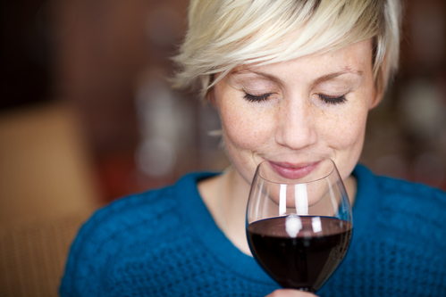 Female Drinking Red Wine With Eyes Closed
